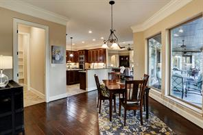 Lovely breakfast area surrounded by windows and views.  Enormous walk-in pantry.  Crown molding flows through out every room of the home.
