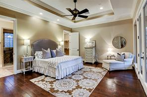 Charming master suite with tray ceiling, two levels of crown molding, and double entrances to the master bath.