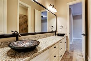 Large additional bathrooms with glass inlayed sink bowls.