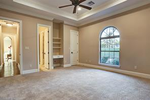 All additional bedrooms are spacious with walk-in closets.  This one comes with a built-in desk and selves.