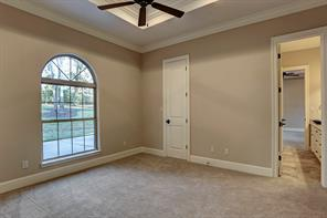 Love the large oval shaped windows with front yard views.