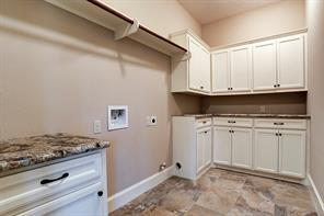 Full size utility room with ample storage.