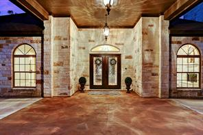 Luxurious front entry to the home built with limestone stacked blocks.  Enter through the large double glass front doors.