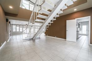 View as you walk in the front door of the floating stair case, off to the right is another entrance to kitchen