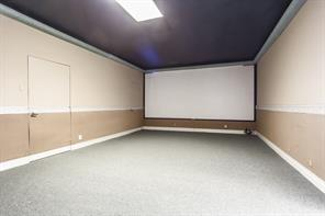 Bedroom 4, set up as a media room. comes with full screen and projector!