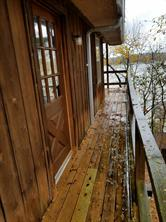View of front porch, which faces sideways. Look at the pretty wood!!