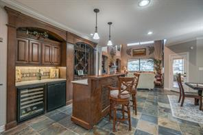 Fantastic wet bar features a wine chiller, beverage refrigerator and 100+ bottle storage!