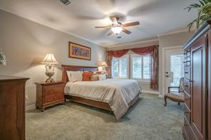 The master suite is spacious and warm and boasts a private entry to the lower level patio.  Step out and enjoy your morning coffee while overlooking Lake Conroe.