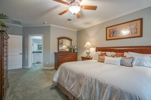 The master can accommodate large furniture and leads directly into the master bath!