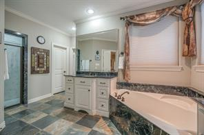 There is also a separate shower and private water closet before leading into the walk-in master closet.