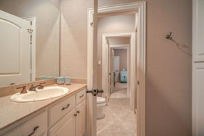 Separate vanities and shared wet area for your family and friends!