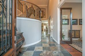 Enter through the wrought iron and leaded glass front door into a majestic two-story entry!  Notice the beautiful slate floors throughout the main level!