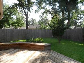Lush landscaping and privacy fence to enjoy the backyard.