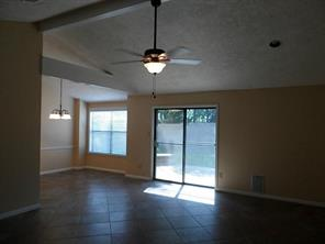 Open living room features tile flooring and high ceilings!