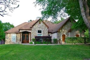 Spring picture of this beautiful custom home on 1+ acre. The home backs to Majestic Lake.