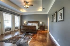 "Another view of the master bedroom and entry to bath is shown. Note the crown moulding and 6"" baseboards."