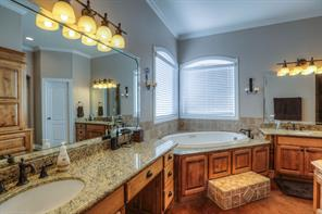 Plenty of storage in the master bath as shown in this view.