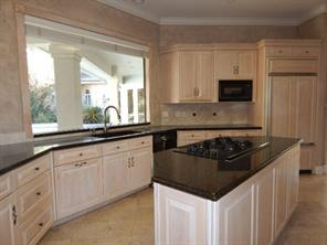 Kitchen with view of pool and golf course.