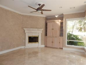 Family room with fireplace and pool access.