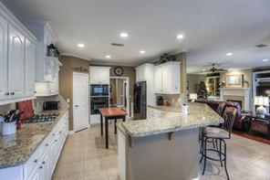 Check out all of the cabinets and pretty granite counter tops.