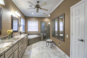 This master bath was renovated in June of 2015. It has dual vanities, garden tub and large walk-in shower with corner seat.