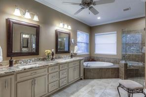 The tile and granite in this master bath is beautiful.