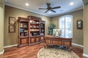 Pretty hardwood floors and plantation shutters give this room a classy feel.