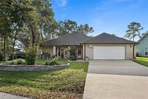 Welcome to your new home! Privacy in abundance and gated waterfront community too! Be ready to spend fun filled days on Lake Conroe and come home to a restful evening in your custom home.