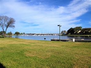 Great view of Lake Conroe and Walden Marina from this ground floor condo.  Roll out of bed and grab your fishing pole!