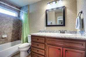 Second full bath also has granite counters along with upgraded lighting and mirror.