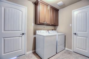 Utility room also has extra cabinets; note oil-rubbed bronze lever door handles are here and throughout the home.