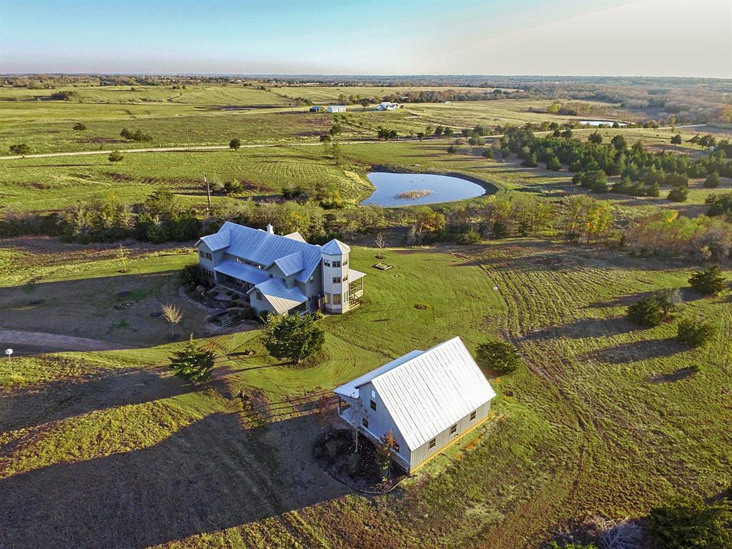 Hilltop home overlooking pond on 27 acres. Wildlife exempt.