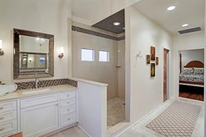 Master bath with double sinks and walk-in shower.