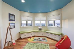 Playroom/Game room (11'x12') on 2nd floor with great built-in storage and window seating.