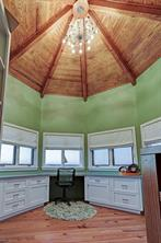 Office (11'x12') with dramatic domed ceiling, built in desk and drawers, and panoramic views of countryside.