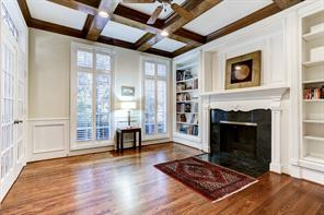 The fireplace is the perfect focal point in the study. Complete with french doors, custom glass transom, wood floors, trey ceiling and custom built in's with a secret panel.