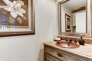 Powder bath located in the hallway leading to the master bedroom.