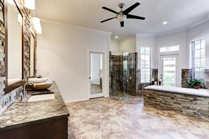 Master bathroom has been updated and offers a spa like feel. Dual closets for additional storage.