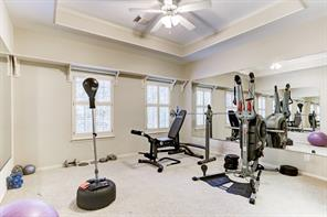 This secondary upstairs bedroom is currently used as a workout room.