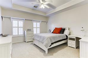 Another secondary upstairs bedroom with shutters and Trey ceiling.
