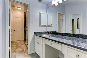 Hollywood bath with granite counters.
