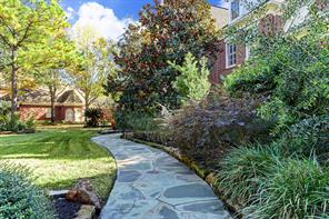 Natural stone walk-way leads you to the front door.