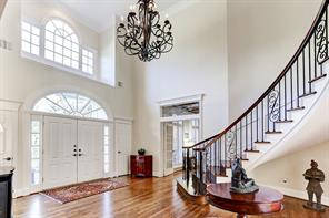 Gorgeous wood floors and curved stairway welcome you.