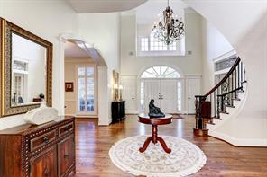This impressive entry way is open to the formal dining room on the right and study on your left.