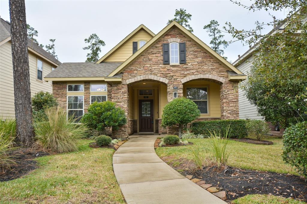 Welcome Home! You're bound to fall in love with this meticulously maintained & upgraded 1-Story Patio Home! Just minutes away from The Woodlands Upscale Shopping, Dining, and Entertainment. The layered natural flag stone make this home stand out from the crowd. Professional landscaping with automatic Sprinkler System. Taking care of your lawn has never been easier!