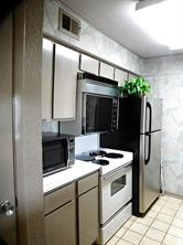 Kitchen is light and bright with stainless refrigerator and clean stove looks new!