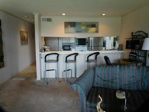 Kitchen has breakfast bar and room for breakfast table or desk area as shown