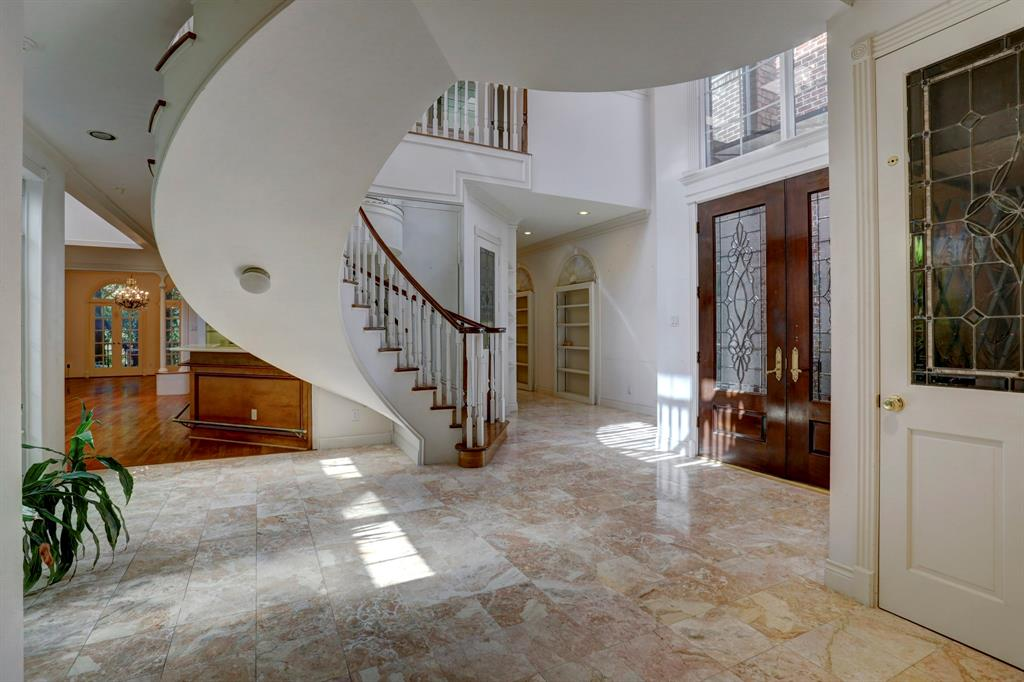 Grand 2 Story Entry With Spiral Staircase. Skylights Above Allow For Lots  Of Natural Light. Elevator, Pictured, Located Conveniently Near Front Door