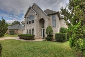 Beautiful all brick home located on the golf course in the April Sound Community.