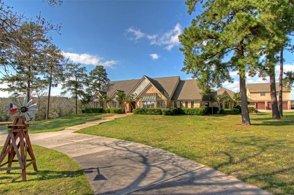 Rare Find Silver Creek Ranch in CONROE 61+/- Ranch Rolling Terrain, Pastures, Ag Exempt, 2 minutes to I-45 & 2 minutes to Lake Conroe! Main House is 6100+/-Square feet with 2 Master Baths, AMAZING 40 KW Generator, In Ground Pool, extensive decking, Circle drive, 4 Car Attached Garage and workshop with additional Garage Apartment. PLUS 3 Car Detached Garage with Apartment or Office above! Cozy Brick Guest House, Front Covered Porch, 3 bedrooms 2.5 baths Nestled Privately away with Water Frontage for serene views! Additional Barns and storage -WOW!
